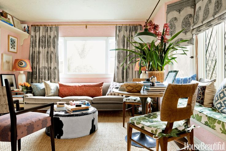 Peter Dunham lives large in his tiny Los Angeles apartment. To lend softness to the living room, he used a milk-paint formula from SafePaint on the walls — White with 10 percent Barn Red — and hung curtains and shades in Isfahan from his Peter Dunham Textiles collection. The Danish sofa is upholstered in Lamu, also from his fabric line. Jute rug, Decorative Carpets. Custom ottoman in a vintage cowhide.