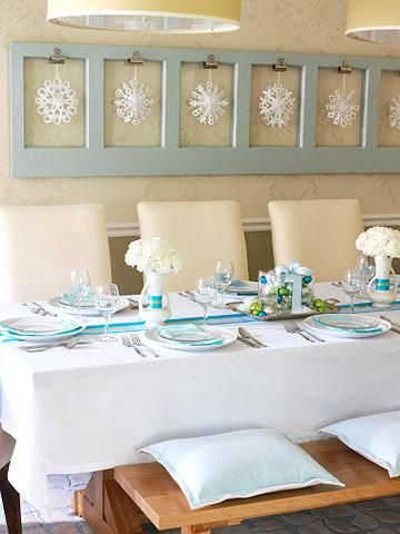 Use ribbons down the center of your table to add color. Click for inexpensive ideas to throw a holiday party!