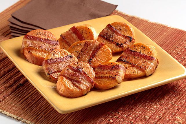 Give sweet potato slices a thrill! Wrap them with halved slices of bacon and let 'em get delicious together in the skillet.