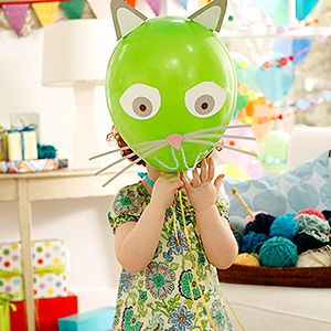 Decorate balloons to look like your furry friends.  Make it: Cut cat features from template from craft or crepe paper and attach them to an inflated balloon with glue dots. Cut 3 thin strips of paper for whiskers and a 6 inch piece of yarn for a mouth; secure in place with glue dots.