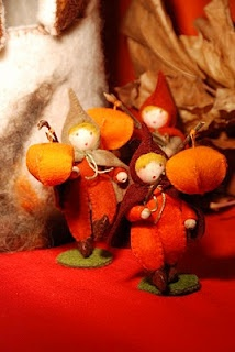 Lantern walkers made them with buckwheats, little wooden pearls and a felt hat- little lampion flowers as lanterns ....
