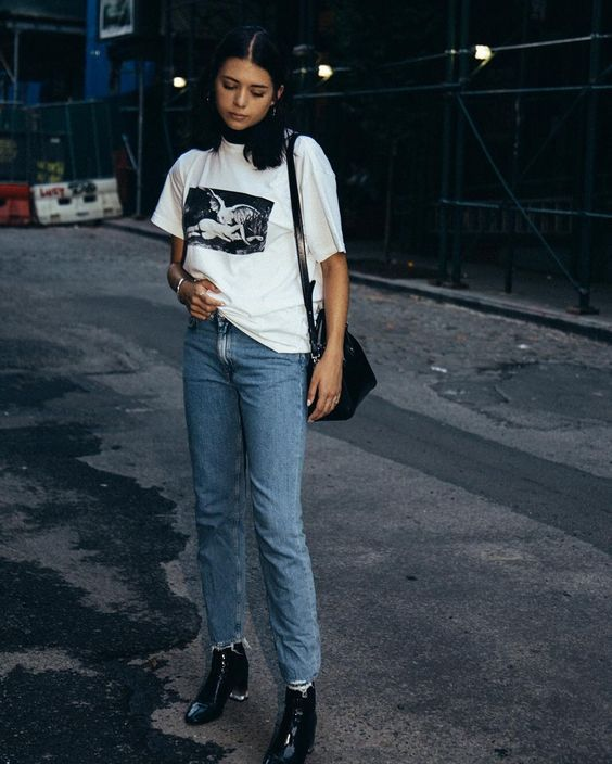 Layer a turtleneck under a graphic t-shirt and jeans for a cool, casual outfit