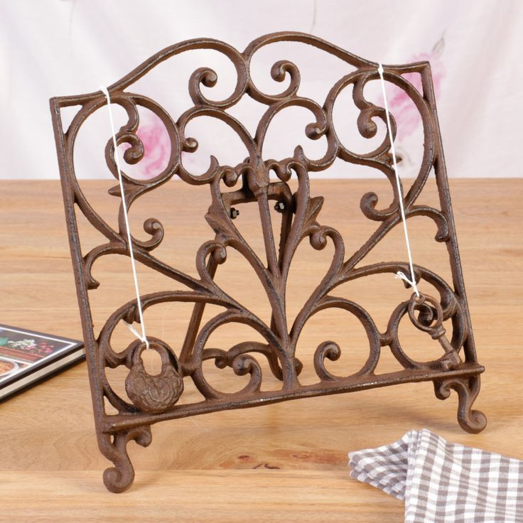 Our beautiful cast iron cookbook stand will look very pretty in any kitchen.  Designed with ornate scroll detailing, finished in antique brown, complete with a scroll top featuring two cotton chains with a lock and a key weight, holding down the pages perfectly in place.  #mothersday #mothersdaygifts #giftidea #cookbookstand #cookbookrack #cookbookholder #countystyle #frenchgift #Dibor