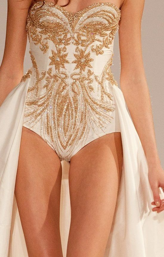 I'm not sure where anyone could wear this but the beading is so detailed and designed perfectly. The train in the back just makes the garment more fantasyish