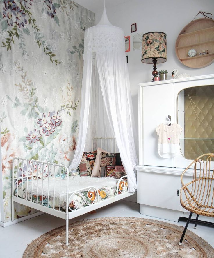 Adorable vintage inspired feminine girls room with floral wallpaper and IKEA Minnen bed.