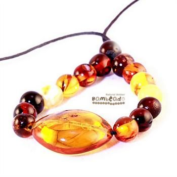 This stylish oval shaped amber pendant is made from polished amber pieces that gets noticed when wearing. Great for little fingers when fingers when feeding.