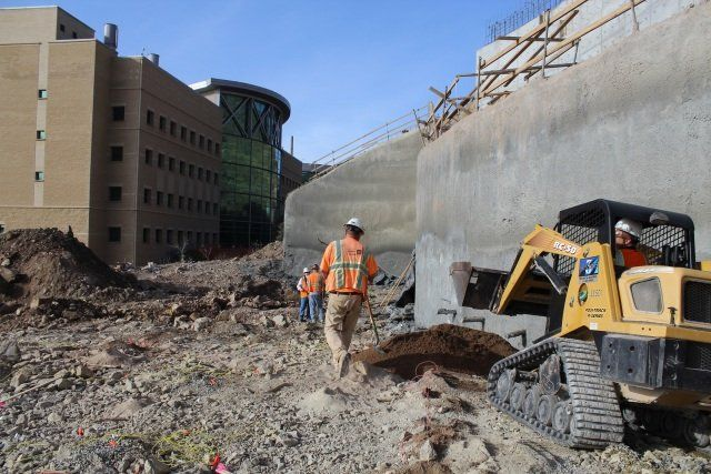 This Construction Site Sure Is Close To That Commercial Building When Looking At Drilling And Blasting It Is Best To W Construction Site Cedar City Rock Face