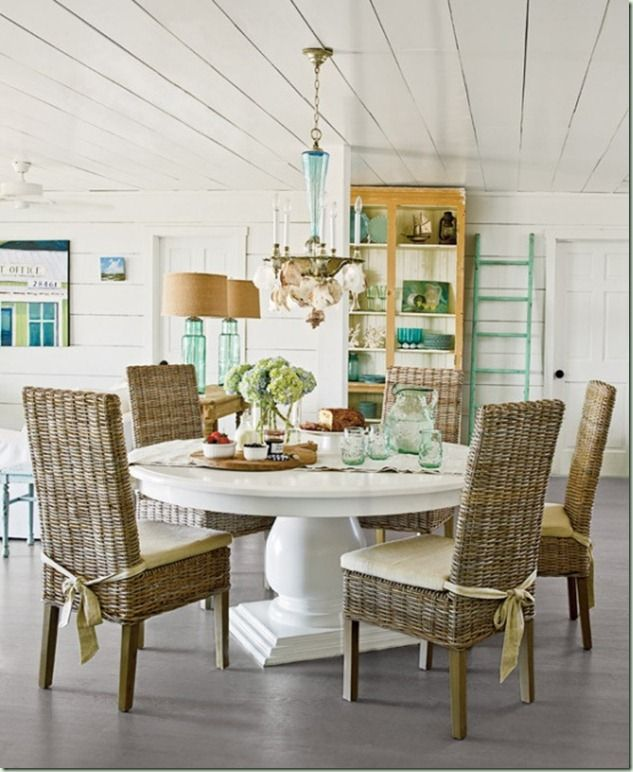 Light fixture. Floor, painted table. Ceiling treatment,  round dining table and nice chairs