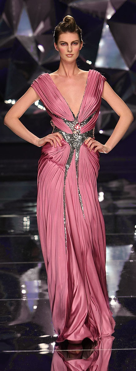 Abed Mahfouz - Couture - Spring-summer 2009 http://en.flip-zone.com/fashion/couture-1/independant-designers-41/abed-mahfouz-858 (Dark Pink)