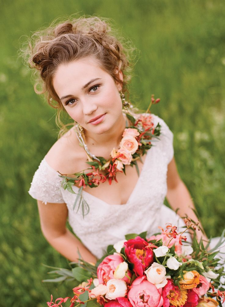 Stunning bridal updo with soft curls and pretty makeup.