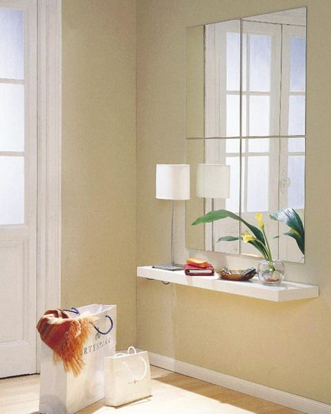 A sleek shelf under the hallway mirror can be a very stylish feature