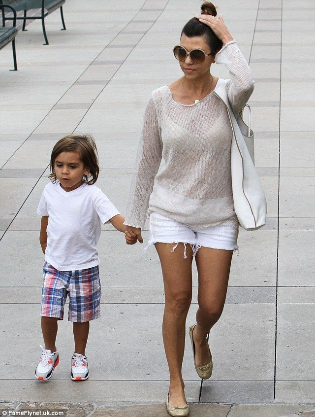 Let's hope he wasn't scared! Kourtney Kardashian cradles son Mason after she and…