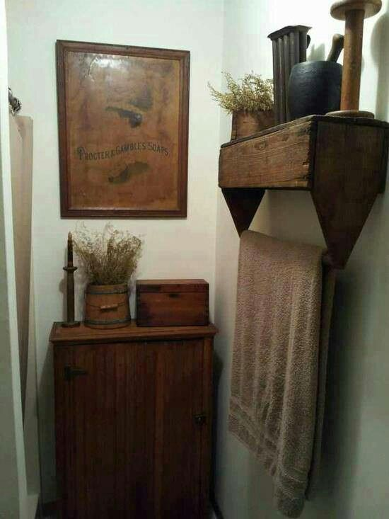 Upside down wooden toolbox repurposed as a shelf/towel bar