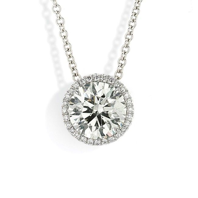 Halo Pendant 3 - Sliding halo pendant necklace with Forevermark round brilliant diamond accented with white diamond melee in 18kt white gold.