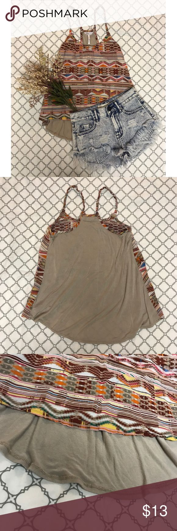 PacSun Tribal Print Tank ✨NWOT, PERFECT CONDITION ✨Material: 100% rayon ✨So so so comfortable! ✨Double straps on the shoulders ✨Front has a tribal print pattern, back is solid tan  ✨Awesome summer top!!! But also great fall colors😊 ✨It would look super cute with jean shorts or jeans and a sweater! PacSun Tops Tank Tops