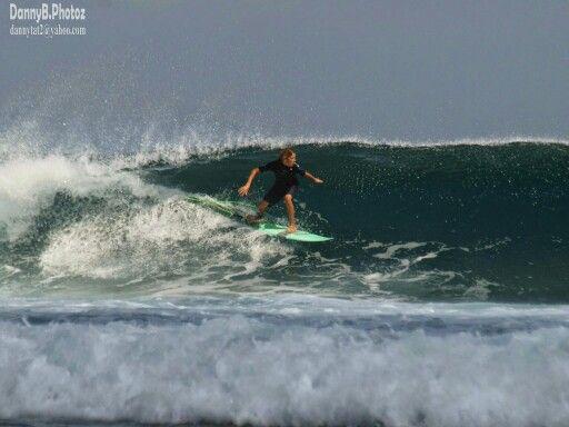 Adam surfing the T land wave