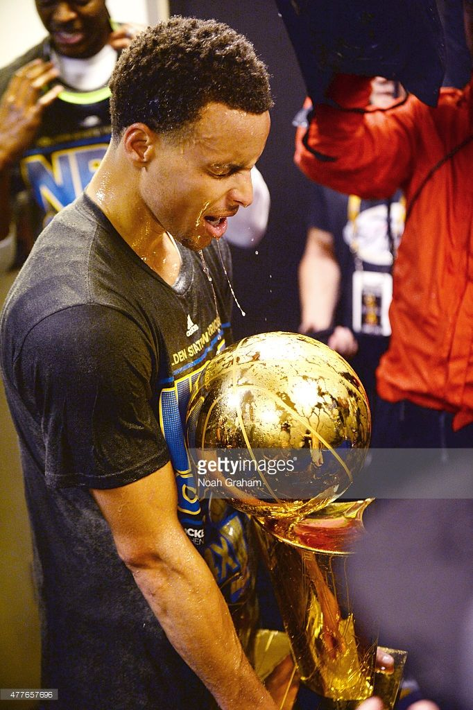 <a gi-track='captionPersonalityLinkClicked' href=/galleries/search?phrase=Stephen+Curry+-+Basketball+Player&family=editorial&specificpeople=5040623 ng-click='$event.stopPropagation()'>Stephen Curry</a> #30 of the Golden State Warriors celebrates winning the Larry O'Brein Trophy after Game Six of the 2015 NBA Finals against the Cleveland Cavaliers at the Quicken Loans Arena on June 16, 2015 in Cleveland, Ohio.