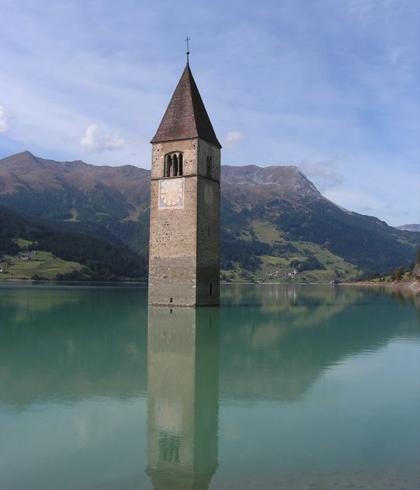 This semi-submerged bell tower is all that can be seen of the church at Curon Venosta, a small Northern Italian town flooded to make way for an artificial lake.