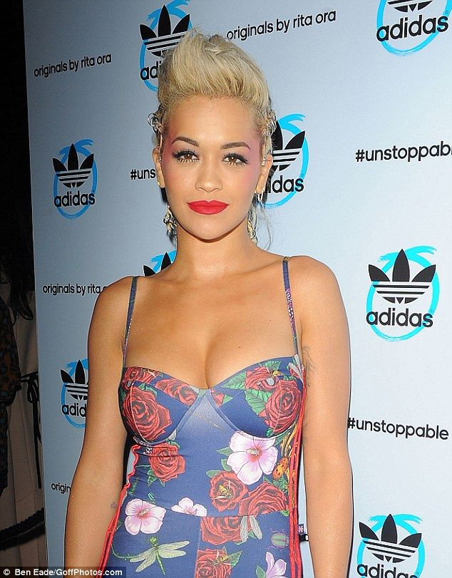 Rocking! Rita wore a mohican-inspired hair do and dramatic make-up but her outfit did all ...