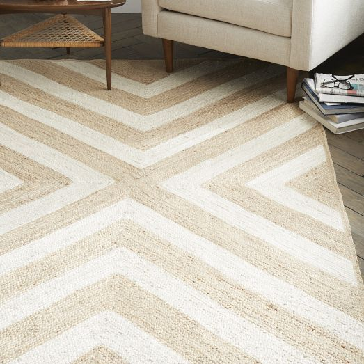 Natural and bleached jute are hand-stitched together to create the subtly-hued geometric pattern of our Rubicon Jute Rug. Durable and great looking, it's ideal for high traffic areas.