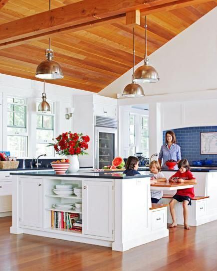 Nautical details and kid-friendly design put the focus on family fun at this busy Nantucket-style lake home in northern Michigan.