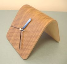 A small desk clock formed in a Bagpress