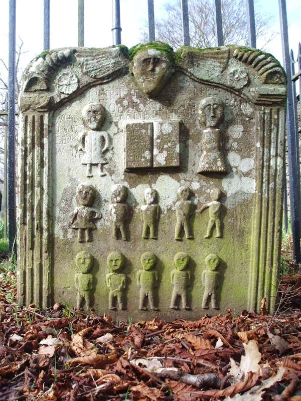 Tragic Scottish stone, likely depicting the deceased of an entire family - Mom,  Dad, 1 girl and 9 boys.