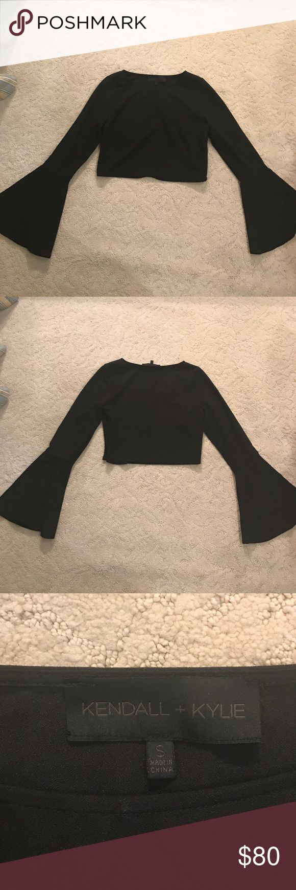 Kendall + Kylie Bell Sleeve shirt Kendall + Kylie black bell sleeve shirt. I have never worn it, it has been sitting in my closet since Christmas. Really cute too though and has been featured on Revolve, Lord &Taylor and Bloomingdale's Kendall & Kylie Tops Crop Tops