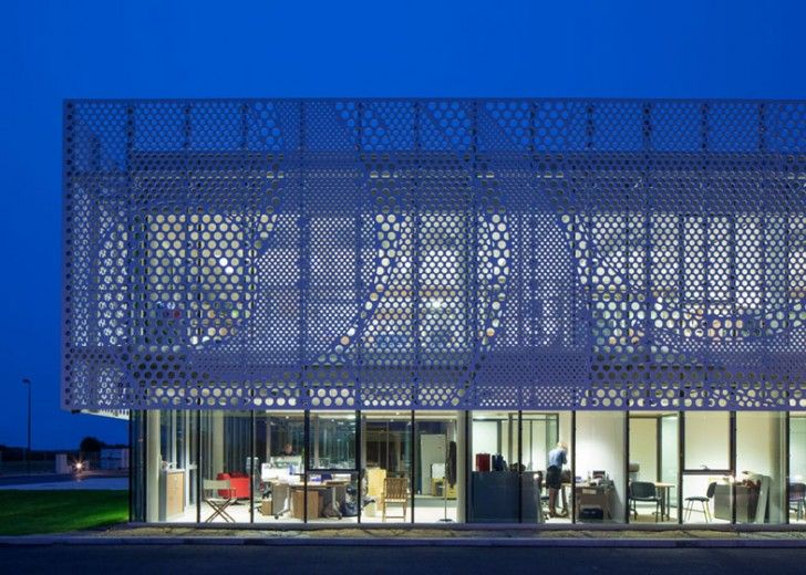 PAD Architects Wraps French Office with a Wavy Perforated Faca...