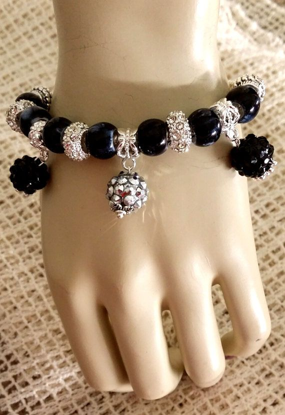 Black Charm bracelet - I'm independant  If Your Favorite Color is Black  So,Prestige and power are important to you. You are independent, strong-willed and determined. like to be in control of yourself and situations. As a lover of black you may be conservative and conventional - black is restricting and contained.