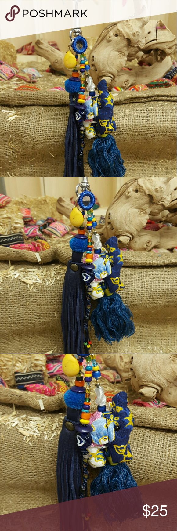 NEW HAND MADE BOHO / FESTIVAL BAG CHARM KEYCHAIN NEW HAND MADE BOHO / FESTIVAL BAG CHARM KEYCHAIN. Hand beaded dangle. Hand madr elephant tassel dangle. Hand made blue leather tassel with pom pom and beads. ( any of my elephant items sold have proceeds that go to a charity for saving the elephants...if you need more info contact me. Help save!!) Bohemian Cowgirl Collection!! Creative Crystal Designs Accessories Key & Card Holders