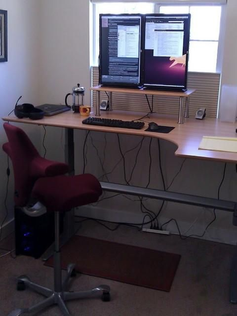 Linux Foundation SysAdmin Michael Halstead's desk, shortly after it was set up. (ie very, very clean)