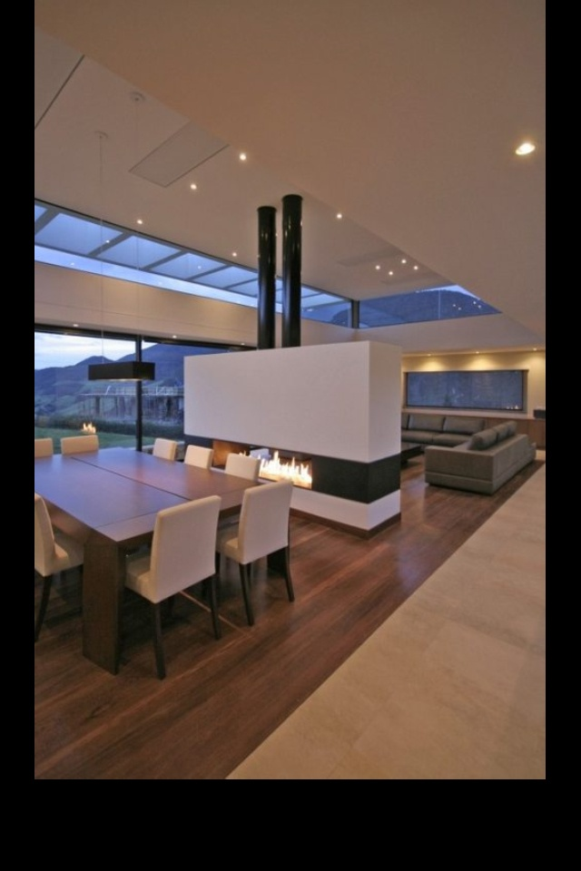 Modern dining room; love the fireplace