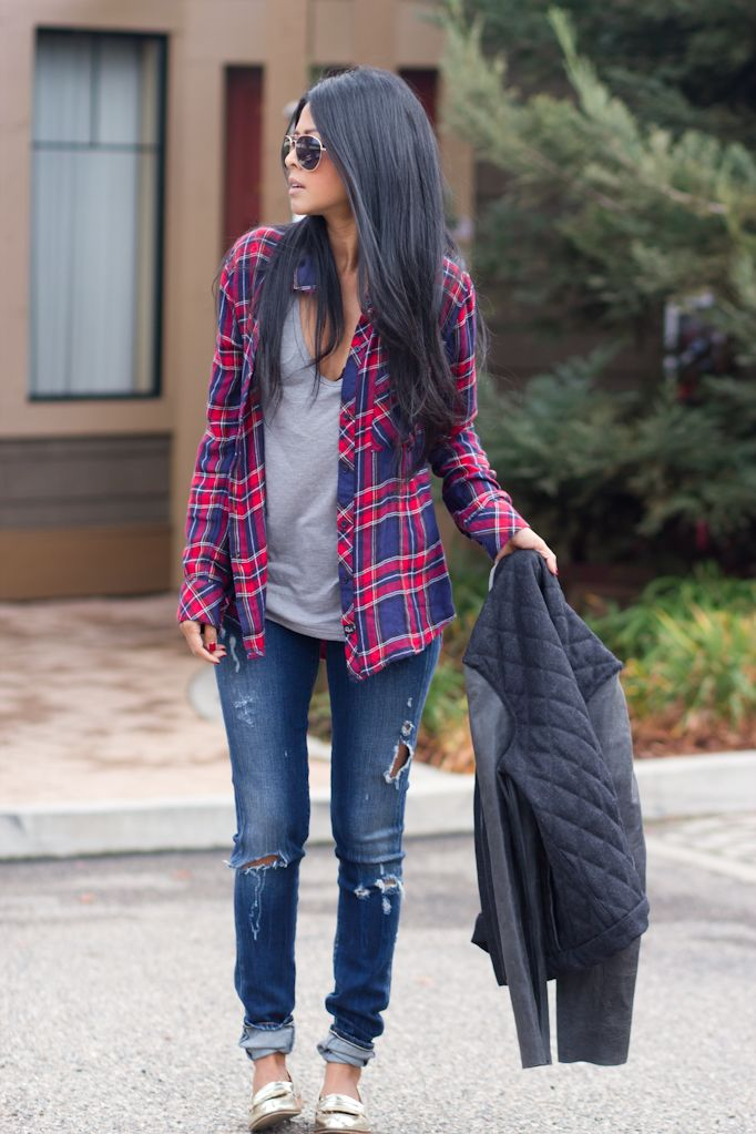 For a throwback, 90s look wear a plaid button-up shirt layered over a T-shirt and distressed denim.