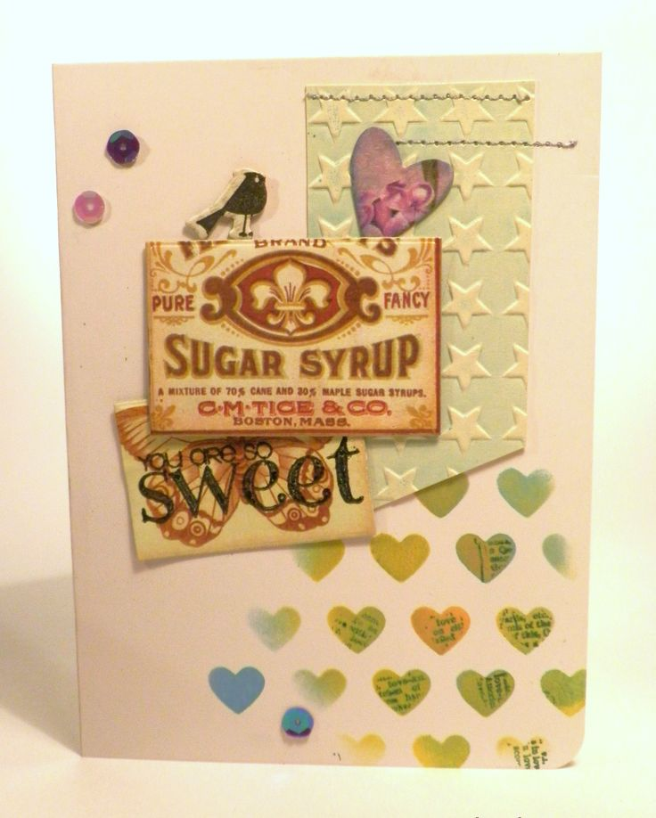 Stamping through a stencil and some homemade embellishments.