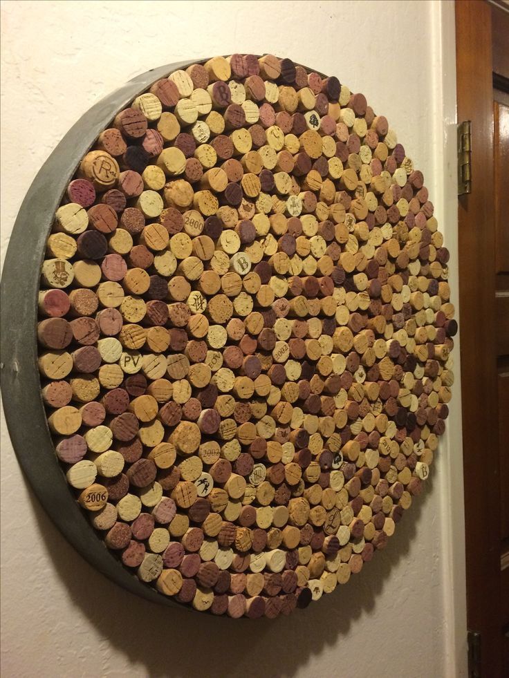 Another custom made Happy Things original.  Wine barrel ring filled with recycled corks. Statement piece for your bar, cork board or great gift!