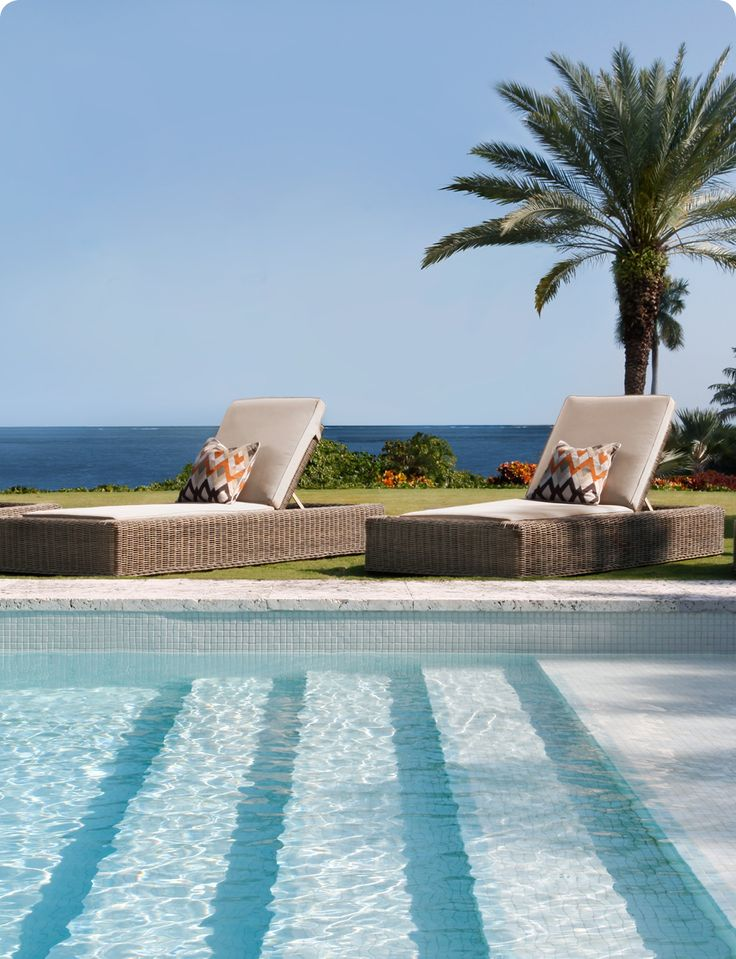 Achieve poolside perfection with a pair of outdoor chaise lounges