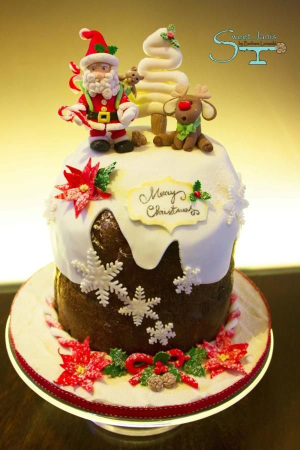 Traditional Panettone decorated for Christmas. Characters are made by fondant, hand modelled. Hope you like it :-) xxx