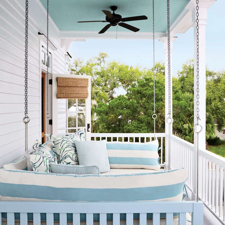 """One of my fondest memories is of sleeping on a hanging bed at my grandparents' fishing camp in Louisiana,"""" Jamie says. """"I wanted to re-create that here."""" She and Rosenberg had a Houston craftsman make a hanging king-size bed outfitted in indoor/outdoor f"""