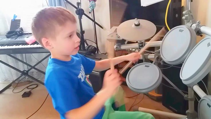 Timmy plays the drums