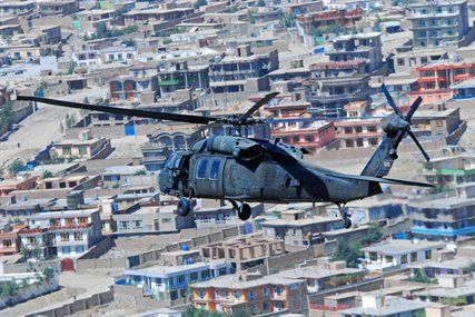 U.S. Army 1st Lt. Chuck Nadd, U.S. Army Chief Warrant Officer 4 Darren Dreher, U.S. Army Staff Sgt. Bruce Kleckner and U.S. Army Sgt. Jay Herring fly a UH-60L Black Hawk helicopter to move personnal over Kabul, Afghanistan, Sept. 4, 2013. Nadd and Dreher, pilots, and Kleckner and Herring, crew chiefs, are assigned to Company A, 2nd Battalion General Support, 104th Aviation Regiment.