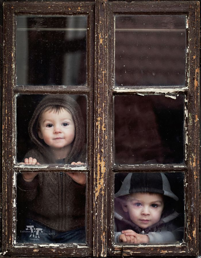 This is adorable. It makes me think of the Alonzo boys looking out of Granny's French doors.