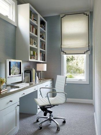 Silvery Blue Office with Eames Management Chair in white leather, neutral Roman shade edged in tealtape, notched at the corners, and white built-ins - San Francisco home by Palmer Weiss in Traditional Home