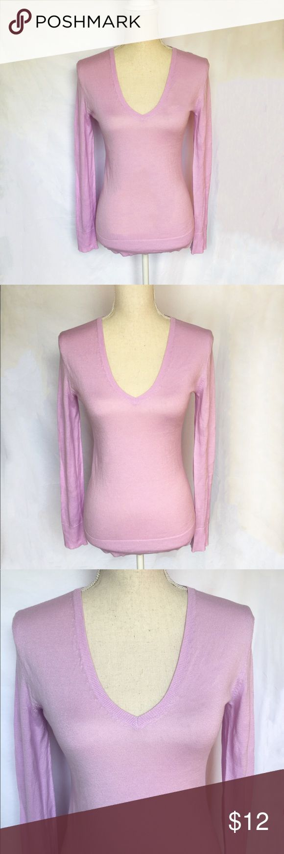 Brand new Gap sexy V neck light sweater Brand new never worn. Beautiful light purple color. 100% cotton material, super soft and comfy. Stretchy, easy to fit with deep V neck, for sexy casual everyday look. And it's a perfect sexy underneath shirt to match with any darker color blazers or jackets. GAP Tops Sweatshirts & Hoodies