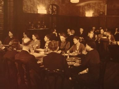 A History of Hull House and Some of Its Famous Residents: Residents of Hull House in the dining room, about 1920