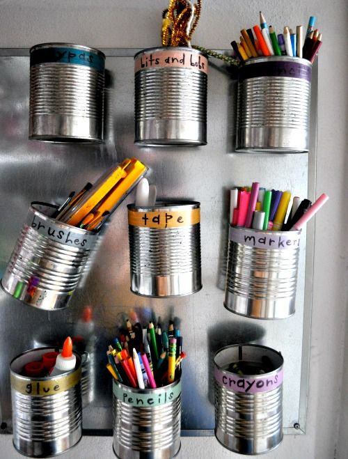 aluminum cans with magnets on the back to organize art supplies.  Excellent idea.