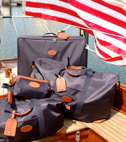 Navy blue Newport bags in different shapes and sizes.