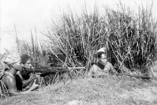 Cambodian partisans under command of a French officer training on a Bren machine gun during the First Indochina War, circa 1948.