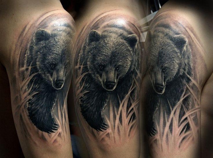 Wonderful running bear tattoo on shoulder