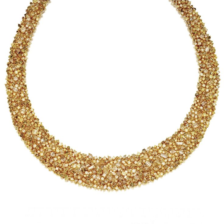 COLORED DIAMOND NECKLACE The flexible tapered bombé collar set with numerous fancy-shaped and round diamonds of various colors weighing a total of approximately 101.00 carats, mounted in 18 karat gold